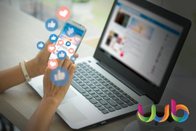 Social Media Management Agency in Surrey - Laptop & Phone with Likes